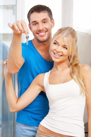 bright picture of happy couple with keys photo