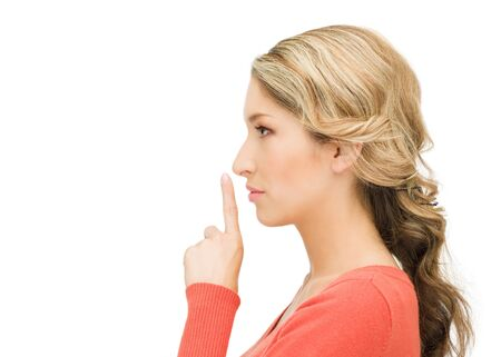 bright picture of woman with finger on lips Stock Photo - 15399932