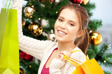 bright picture of happy woman with shopping bags and christmas tree      Stock Photo - 15399582