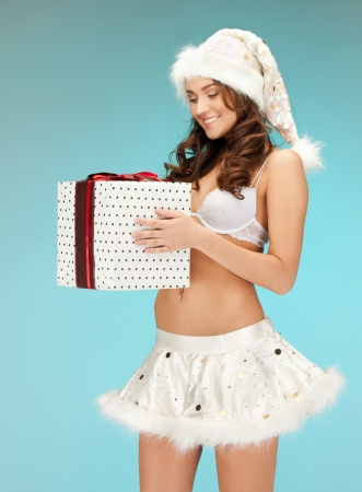santa lingerie: picture of cheerful santa helper girl in lingerie with gift box   Stock Photo