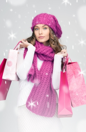 christmas shopping: lovely woman with shopping bags over white