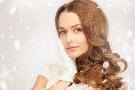 winter woman: picture of beautiful woman in white gloves