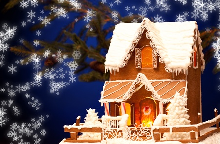 home baked: picture of gingerbread house over christmas background Stock Photo