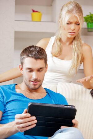 jealousy: bright picture of couple with tablet PC