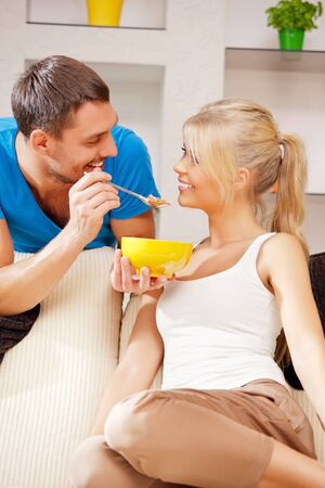 bright picture of happy couple with muesli Stock Photo - 15446047