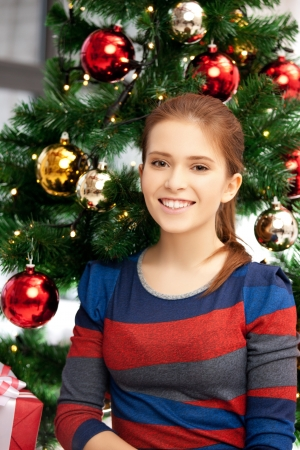 bright picture of happy and smiling woman with christmas tree Stock Photo - 15446051