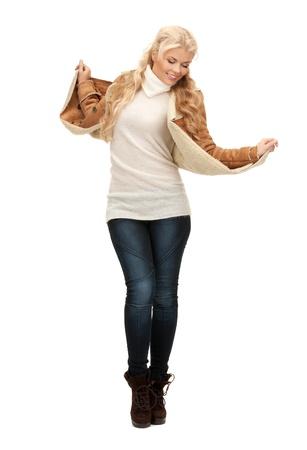 sheepskin: picture of dancing woman in sheepskin jacket Stock Photo