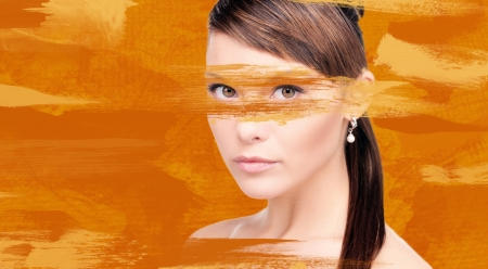 bright picture of lovely woman with orange paint photo