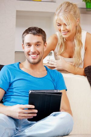 bright picture of happy couple with tablet PC  focus on man  Stock Photo - 15452184