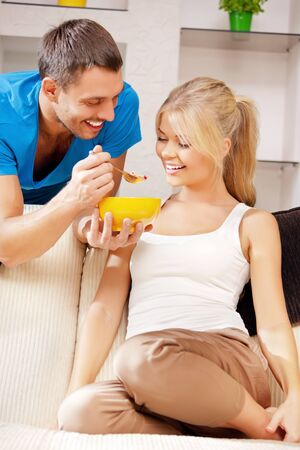 bright picture of happy couple with muesli  focus on man Stock Photo - 15452176
