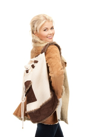 picture of woman in sheepskin jacket with backpack Stock Photo - 15452165