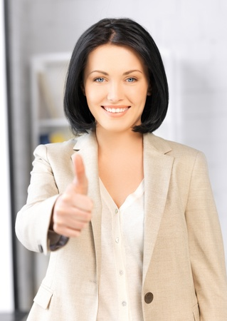 bright picture of young woman with thumbs up Stock Photo - 15482412