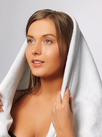 bright picture of beautiful woman in towel Stock Photo - 15575126
