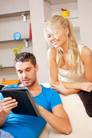 bright picture of happy couple with tablet PC  focus on man  photo