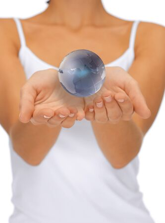 bright closeup picture of woman hands holding earth globe photo