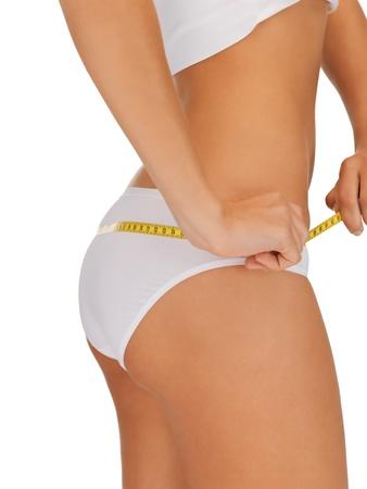 cuerpo femenino perfecto: foto de primer plano de la mujer con cinta métrica Foto de archivo