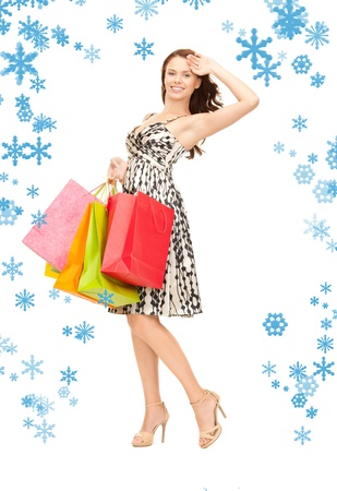 lovely woman with shopping bags over white Stock Photo - 15574749