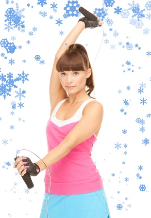 lovely fitness instructor with jump rope over white Stock Photo - 15574745