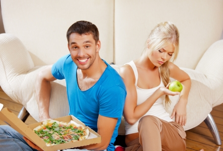 bad man: bright picture of couple eating different food Stock Photo