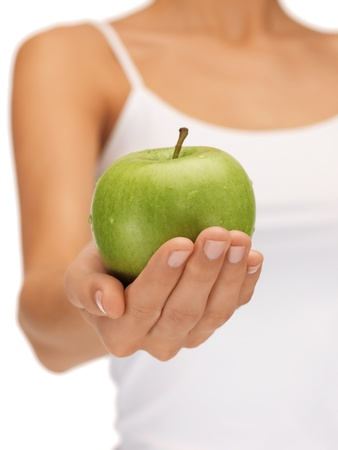 bright picture of female hands with green apple Stock Photo - 15618730