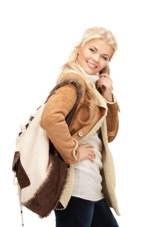 picture of woman in sheepskin jacket with backpack Stock Photo - 15618703
