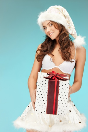 santa helper: picture of cheerful santa helper girl in lingerie with gift box   Stock Photo