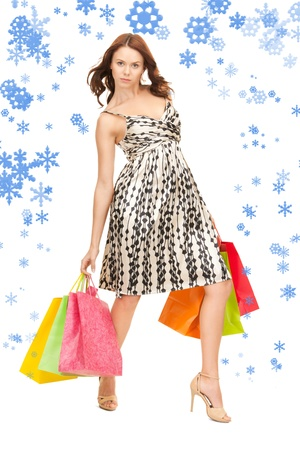 lovely woman with shopping bags over white  Stock Photo - 15618705