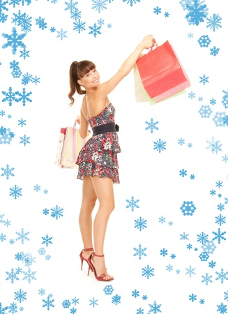lovely woman with shopping bags over white Stock Photo - 15618690