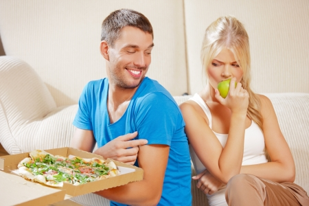 bright picture of couple eating different food  focus on man  photo