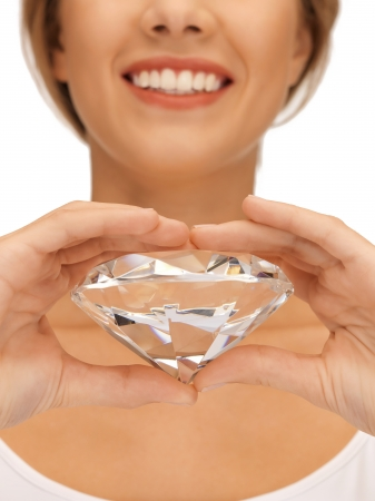jewel hands: bright picture of smiling woman with big diamond