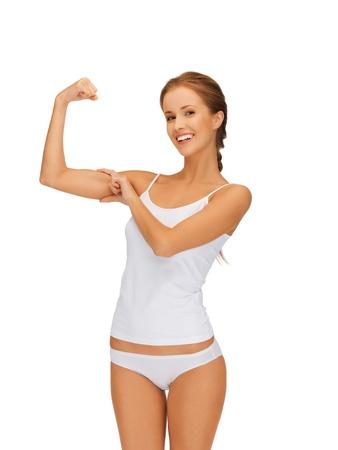 cuerpo femenino perfecto: Foto de mujer deportivo en undrewear algodón flexionando sus bíceps