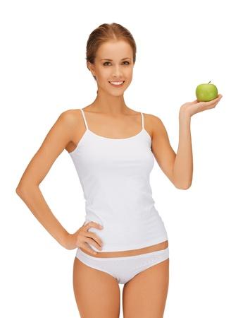 Foto di donna bellissima con mela verde