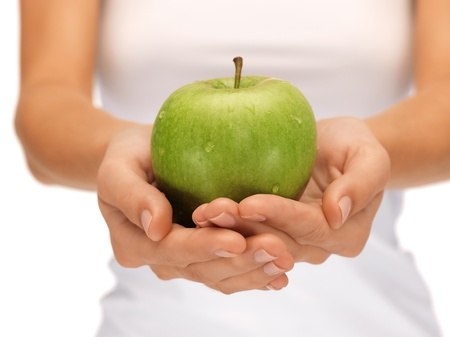 bright picture of female hands with green apple Stock Photo - 15692095