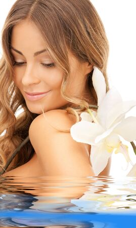aqua flowers: picture of beautiful woman with orchid flower in water