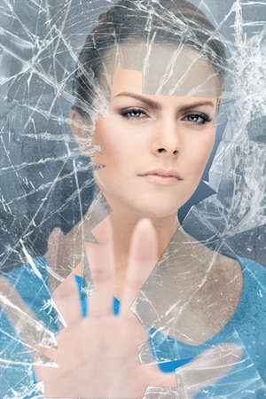 bright picture of young woman breaking glass Stock Photo - 15692116