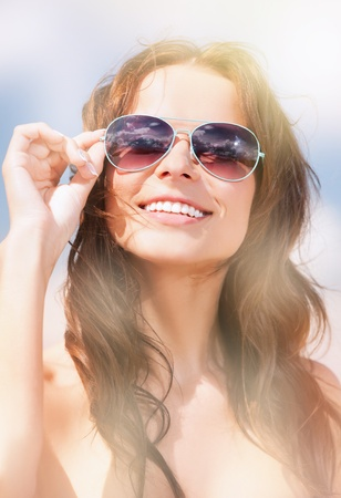 releaxed: picture of beautiful woman in sunglasses on a beach