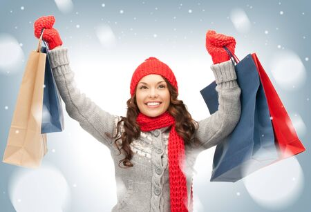 winter sales: picture of lovely woman with shopping bags