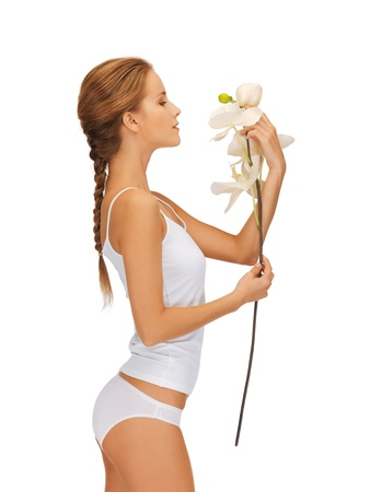 cotton panties: bright picture of lovely woman with orchid flower  Stock Photo