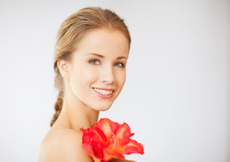 bright picture of lovely woman with lily flower Stock Photo - 15737818