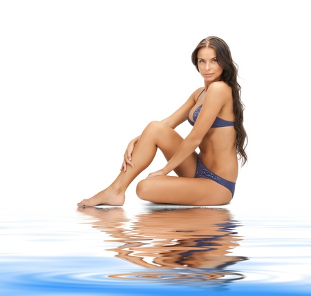 releaxed: bright picture of beautiful woman in bikini on white sand