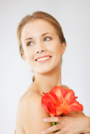 bright picture of lovely woman with lily flower  Stock Photo - 15760327