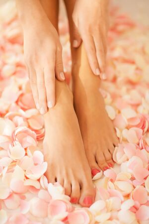 bodycare: closeup picture of female hands and legs
