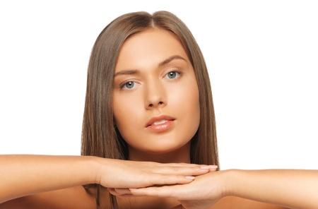 visage: cara y manos de mujer hermosa con el pelo largo Foto de archivo