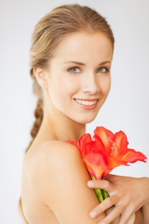 bright picture of lovely woman with lily flower Stock Photo - 15784407