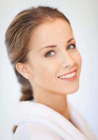 beautiful face: bright closeup portrait picture of beautiful woman in bathrobe Stock Photo