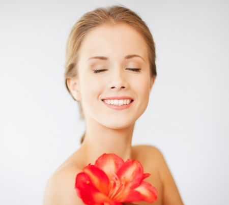 bright picture of lovely woman with lily flower Stock Photo - 15803536