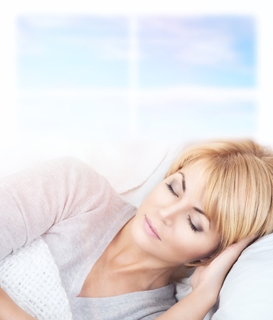 bright closeup picture of beautiful sleeping woman  photo