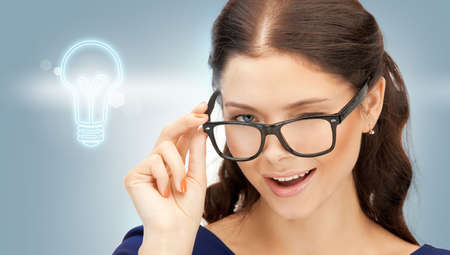 bright picture of happy and smiling woman in specs photo