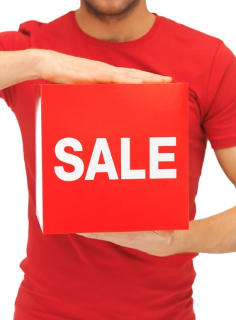 bright picture of man holding sale sign  photo