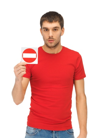 bright picture of man holding no entry sign   Stock Photo - 15871801